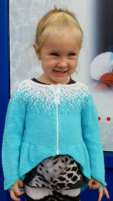 Elsa Cardigan Knitting Pattern by Helga Linnet | Frozen Inspired Knitting Patterns at https://intheloopknitting.com/frozen-knitting-patterns