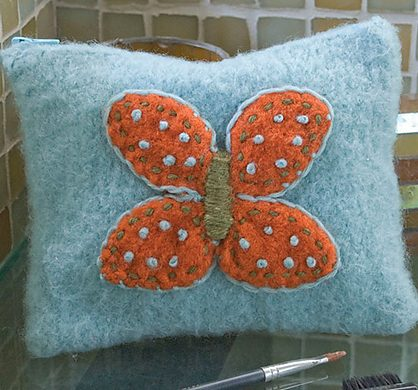 Free knitting pattern for Felted Butterfly Makeup Bag