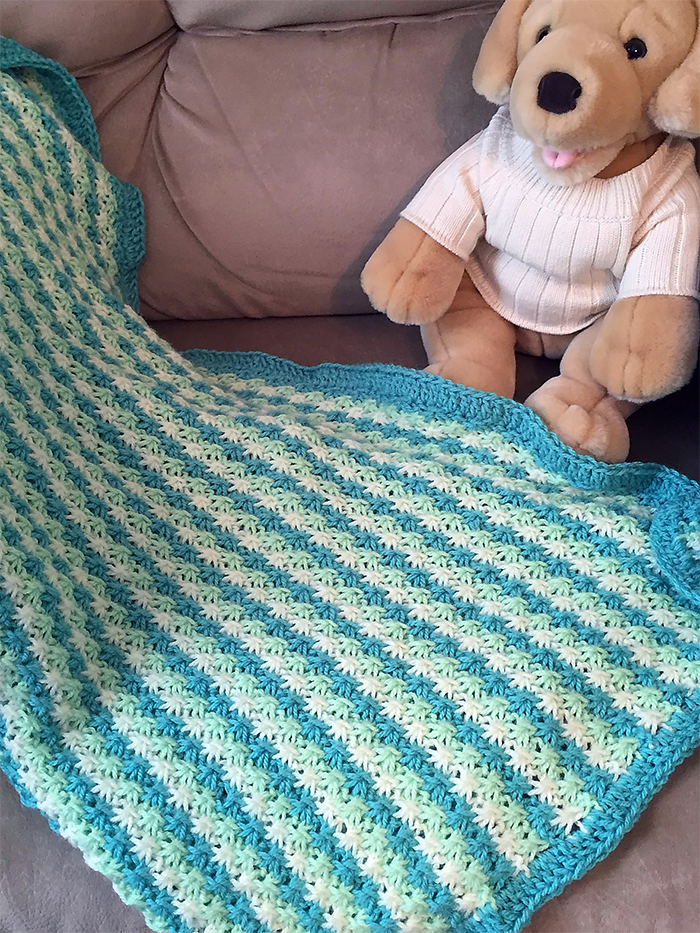 Free knitting pattern for Daisy Stitch Baby Blanket and more baby blanket knitting patterns