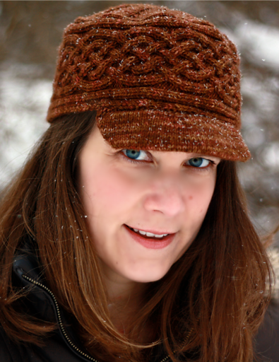 Knitting pattern for Honeysuckle Hat featuring cables and brim