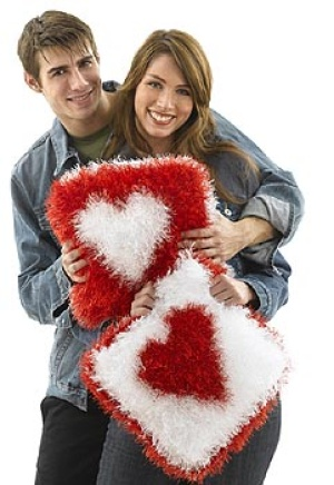 Fuzzy heart pillows free knitting pattern. More free knitting patterns at www.terrymatz.biz/intheloop