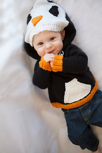 Knitting pattern for Happy Penguin Hoodie Sweater Child's pullover sweater in sizes Newborn (3 months, 6 months, 9 months, 12 months) 2, 4, 6, 8, 10 years. Hood looks like the penguin's head while pocket panel in the front is colored white like a penguin's breast.