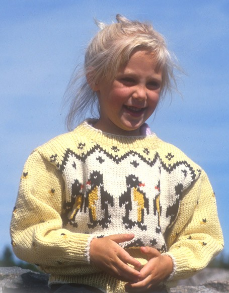 Free knitting pattern for children's sweater with penguins