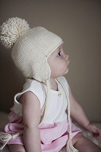 Free knitting pattern for Baby Earflap Hat knit seamlessly with braided  ties and optional pompom 949f94238b7
