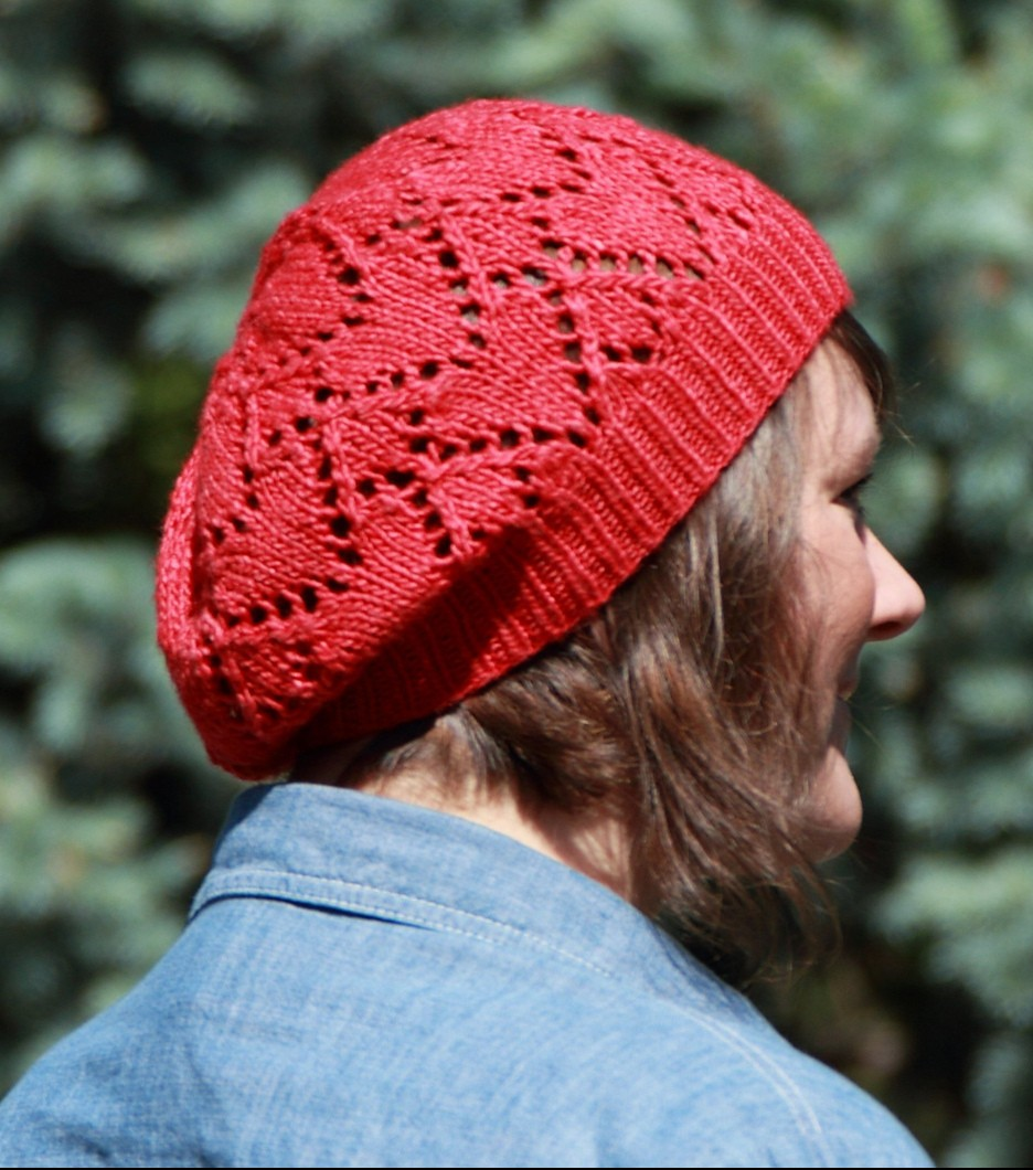 Free knitting pattern for Ruby Red Heart Hat a slouchy beret with heart lace motif