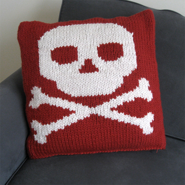Free Knitting Pattern for Skull and Crossbones Cushion Cover