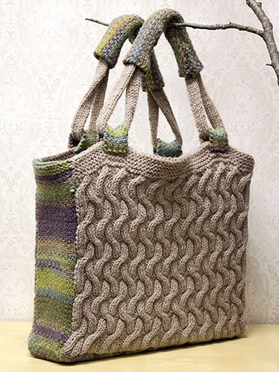 Visby Purse Knitting Pattern with cables | Free Knitting Patterns for Bags, Purses, and Totes at https://intheloopknitting.com/bag-purse-and-tote-free-knitting-patterns/