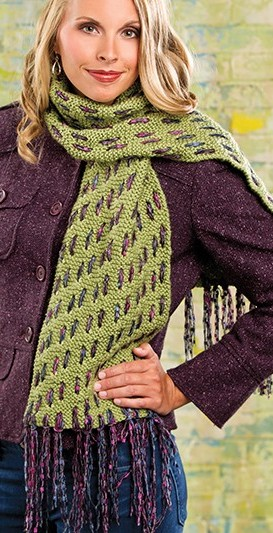 Free knitting pattern for Woven Mesh Scarf and more colorful scarf knitting patterns. I love this idea! Lee Gant designed this easy garter stitch scarf dressed up by weaving yarn strands through the scarf that end up as fringe. Ingenious!